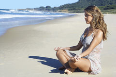 Peaceful Woman Practicing Yoga On Sandy Beach Stock Image