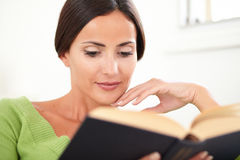 Peaceful woman reading a book at indoors Stock Photos