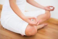 Peaceful woman sitting in lotus pose Stock Photos
