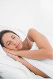 Peaceful woman sleeping in bed Stock Photos