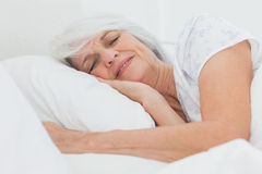 Peaceful woman sleeping Stock Images