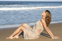 Peaceful Woman In Summer Dress Sitting Sandy Beach Royalty Free Stock Images
