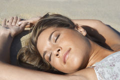 Peaceful Woman Sunbathing On Beach Royalty Free Stock Photo