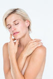 Peaceful woman touching her neck. On white background Royalty Free Stock Image