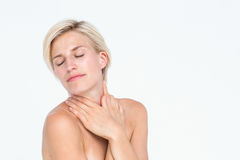 Peaceful woman touching her neck. On white background Stock Photography