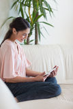 A peaceful woman using a tablet computer Stock Photography