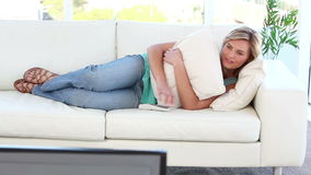 Peaceful woman watching the television stock footage