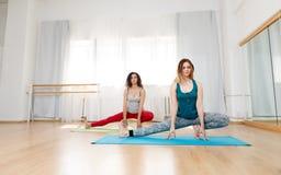 Peaceful women in yoga pose meditating Royalty Free Stock Photo