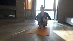 Peaceful yoga. Happy and beautiful woman doing exercise of yoga at home. stock video