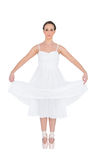 Peaceful young ballet dancer standing on her tiptoes Royalty Free Stock Photos