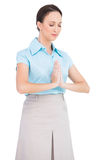 Peaceful young businesswoman praying Stock Photo
