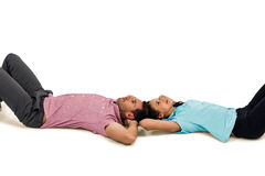 Peaceful young couple laying on floor with hands on their heads Royalty Free Stock Image