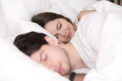 Peaceful young couple sleeping comfortably in cozy bed at home Royalty Free Stock Image