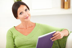Peaceful young female holding a tablet Royalty Free Stock Photo