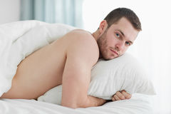 Peaceful young man lying on his belly Stock Photography
