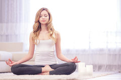 Peaceful young meditating woman Royalty Free Stock Images