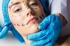 Peaceful young patient with dotted lines on the face Stock Images