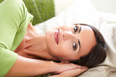 Peaceful young woman lying on her back Stock Photos