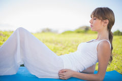 Peaceful young woman relaxing on her mat Royalty Free Stock Photo