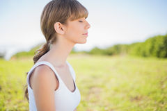 Peaceful young woman relaxing outside Royalty Free Stock Photo