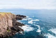 Peacefull Blue ocean and Irish Cliffs Stock Photos
