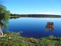 Peacefull Karelian lake. This is the picture of the quiet Karelian lake, cloudless sky and the distant forest stock photo