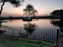Peacefull Sunset. Beautful lake, with a small island in the middle. Sunset compliments the overall beauty Stock Photos