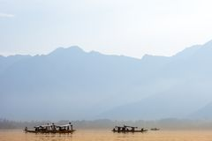 Peacefully Dal lake with snow mountain background in Srinagar, Kashmir India Royalty Free Stock Photography