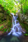 Peacefully flowing stream and waterfalls Stock Photos