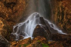 Peacefully flowing stream and waterfalls Royalty Free Stock Photos