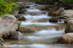 Peacefully flowing stream and waterfalls Royalty Free Stock Photography
