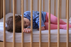Peacefully sleeping todler. Baby girl dreaming during the day in her cot Royalty Free Stock Photos