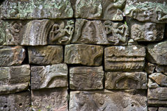 Peaces of carved stones in Angkor Wat Royalty Free Stock Photos