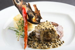 Peaces of meat with garnish Stock Photography