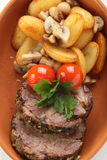 Peaces of meat with garnish Royalty Free Stock Photos