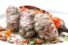 Peaces of meat with garnish Stock Photos