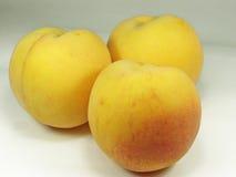 Peach. Three sweet peaches stock image