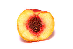 Peach. Half of peach on a white background Royalty Free Stock Photography