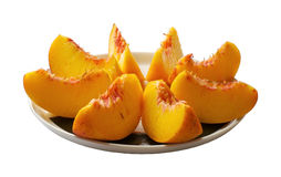 Peach. Sliced peach on the plate Stock Photos