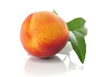 Peach. Fresh peach with leaves isolated on white royalty free stock image