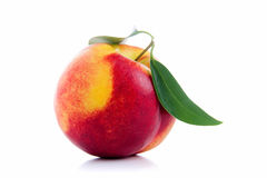 Peach. With green leaves on white  background Royalty Free Stock Photo