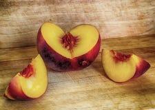 Peach. Sliced peach on a wooden table Stock Photo