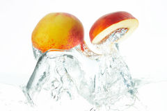 Peach. Two peaches jumping out of the water Stock Images