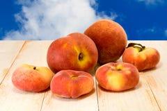 Peach against the sky closeup Stock Photo
