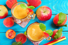 Peach and apple smoothie Stock Photos