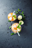 Peach Aqua Fresca with Lime Juice and Mint Leaves Royalty Free Stock Photography