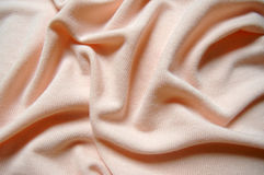 Peach background, tender cloth, soft jersey. Peach background fabric, tender cloth, soft jersey Stock Photography