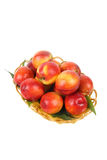 Peach in basket Royalty Free Stock Photos