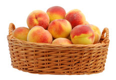 Peach in basket. Basket full of fresh peaches isolated on white background Royalty Free Stock Photography