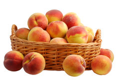Peach in basket. Basket full of fresh peaches isolated on white background Stock Photos